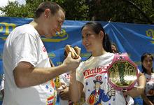 Five-time hot-dog eating world champion Joey Chestnut, left, stares down women's record-holder Sonya