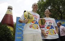 Five-time hot dog-eating world champion Joey Chestnut, left, and women's record-holder Sonya