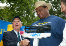 FILE - In this July 3, 2003, file photo, New York City Mayor Michael Bloomberg checks the weight of South Carolina hot dog eating champion and former Chicago Bears defensive tackle William