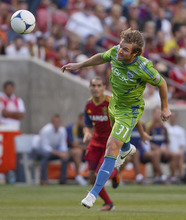 Michael Mangum  |  Special to the Tribune  Seattle Sounders defender Jeff Parke (31) heads the ball to the safety of his defense during their match against Real Salt Lake at Rio Tinto Stadium in Sandy, UT on Wednesday, July 4, 2012.