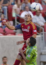 Michael Mangum  |  Special to the Tribune  Real Salt Lake forward Fabian Espindola (7) goes up for a head ball against Seattle Sounders defender Leo Gonzalez (12) during their match at Rio Tinto Stadium in Sandy, UT on Wednesday, July 4, 2012.