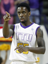Tennessee Tech's Kevin Murphy (55) points to a teammates after hitting a 3-point shot in the first half of an NCAA college basketball game against Murray State on Saturday, Feb. 25, 2012, in Cookeville, Tenn. (AP Photo/Wade Payne)
