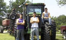 This frame grab from video shows Assaria, Kan., brothers, from left: Nathan; Greg and Kendal Peterson in their video parody on LMAFO's