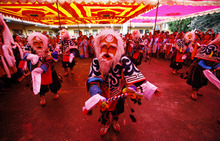 Tibetan exiles perform a mask dance as they mark the birthday of their spiritual leader the Dalai Lama at a monastery in Katmandu, Nepal, Friday, July 6, 2012. The well wishers celebrate the 77th birthday of the Dalai Lama, who lives in the northern Indian town of Dharmsala after his exile from Tibet during a failed revolt against Chinese rule. (AP Photo/Niranjan Shrestha)