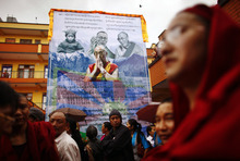 Tibetans gather to mark the birthday of their spiritual leader the Dalai Lama at a monastery in Katmandu, Nepal, Friday, July 6, 2012. Festivities are held to mark the 77th birthday of the Dalai Lama, who lives in the northern Indian town of Dharmsala after his exile from Tibet during a failed revolt against Chinese rule. (AP Photo/Niranjan Shrestha)