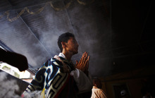 A Tibetan man prays at a monastery in Katmandu, Nepal, Friday, July 6, 2012. Festivities are held to mark the 77th birthday of the Dalai Lama, who lives in the northern Indian town of Dharmsala after his exile from Tibet during a failed revolt against Chinese rule. (AP Photo/Niranjan Shrestha)