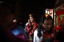 A Tibetan school girl prepares to perform at a cultural show in Katmandu, Nepal, Friday, July 6, 2012. Festivities are held to mark the 77th birthday of Tibetan spiritual leader the Dalai Lama, who lives in the northern Indian town of Dharmsala after his exile from Tibet during a failed revolt against Chinese rule. (AP Photo/Niranjan Shrestha)