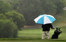 Steve Griffin | The Salt Lake Tribune   Golfers at Bonneville Golf Course in Salt Lake City, Utah, needed umbrellas to finish their rounds as rain showers moved through the city Thursday July 5, 2012.