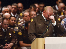 Leah Hogsten     The Salt Lake Tribune Utah Highway Patrol Trooper Arik Beesley pauses for a moment while talking about his brother Trooper Aaron Beesley and his accomplishments during funeral Saturday, July 7, 2012 in Layton at Northridge High School.