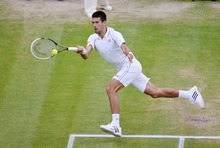 Novak Djokovic of Serbia plays a shot to Roger Federer of Switzerland during a men's semifinals match at the All England Lawn Tennis Championships at Wimbledon, England, Friday, July 6, 2012. (AP Photo/Miguel Medina, Pool)