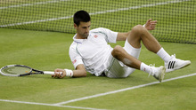 Novak Djokovic of Serbia gets up after missing a shot against Roger Federer of Switzerland during a men's semifinals match at the All England Lawn Tennis Championships at Wimbledon, England, Friday, July 6, 2012. (AP Photo/Kirsty Wigglesworth)