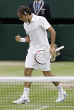 Roger Federer of Switzerland reacts after winning a set against Novak Djokovic of Serbia during a semifinals match at the All England Lawn Tennis Championships at Wimbledon, England, Friday, July 6, 2012.  (AP Photo/Kirsty Wigglesworth)