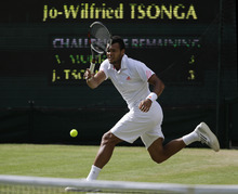 Jo-Wilfried Tsonga of France plays a shot to Andy Murray of Britain during a men's semifinals match at the All England Lawn Tennis Championships at Wimbledon, England, Friday, July 6, 2012. (AP Photo/Alastair Grant)