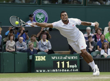 Jo-Wilfried Tsonga of France plays a return to Andy Murray of Britain during a semifinals match at the All England Lawn Tennis Championships at Wimbledon, England, Friday, July 6, 2012. (AP Photo/Anja Niedringhaus)