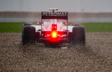 Germany's Michael Schumacher driving a Mercedes Formula 1 car drives through a gravel trap at Club corner during qualifying at the Silverstone circuit, England, Saturday, July 7, 2012. The qualifying session will establish the starting positions for the British Grand Prix at Silverstone circuit on Sunday. (AP Photo/Tom Hevezi)