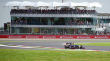 Australia's Mark Webber driving a Red Bull Racing-Renault Formula 1 car takes Luffield corner during practice at the Silverstone circuit, England, Saturday, July 7, 2012. The Formula 1 teams make preparations ahead of the British Grand Prix at Silverstone circuit on Sunday. (AP Photo/Tom Hevezi)