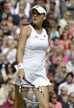 Agnieszka Radwanska of Poland reacts after winning the second set against Serena Williams of the United States during the women's final match at the All England Lawn Tennis Championships at Wimbledon, England, Saturday, July 7, 2012. (AP Photo/Alastair Grant)