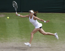 Agnieszka Radwanska of Poland plays a shot to Serena Williams of the United States during the women's final match at the All England Lawn Tennis Championships at Wimbledon, England, Saturday, July 7, 2012.. (AP Photo/Anja Niedringhaus, Pool)