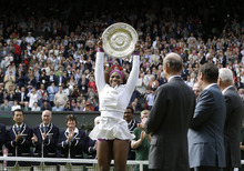 Serena Williams of the United States, center, celebrates with the trophy after defeating Agnieszka Radwanska of Poland to win the women's final match at the All England Lawn Tennis Championships at Wimbledon, England, Saturday, July 7, 2012. (AP Photo/Kirsty Wigglesworth)