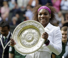 Serena Williams of the United States poses with the trophy after defeating Agnieszka Radwanska of Poland to win the women's final match at the All England Lawn Tennis Championships at Wimbledon, England, Saturday, July 7, 2012. (AP Photo/Kirsty Wigglesworth)