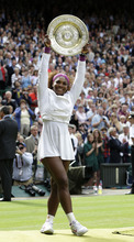 Serena Williams of the United States celebrates with the trophy after defeating Agnieszka Radwanska of Poland to win the women's final match at the All England Lawn Tennis Championships at Wimbledon, England, Saturday, July 7, 2012. (AP Photo/Kirsty Wigglesworth)