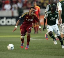Kim Raff | The Salt Lake Tribune Real Salt Lake player Javier Morales reacts to being tripped up by Portland Timbers player Diego Chara at Rio Tinto Stadium in Sandy, Utah on July 7, 2012.