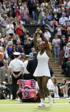 Serena Williams of the United States reacts after defeating Agnieszka Radwanska of Poland to win the women's final match at the All England Lawn Tennis Championships at Wimbledon, England, Saturday, July 7, 2012. (AP Photo/Kirsty Wigglesworth)