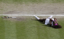 Serena Williams of the United States reacts after defeating Agnieszka Radwanska of Poland to win the women's final match at the All England Lawn Tennis Championships at Wimbledon, England, Saturday, July 7, 2012.. (AP Photo/Anja Niedringhaus, Pool)
