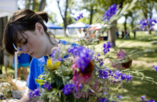 Kim Raff | The Salt Lake Tribune Fiona Spas prepares a flower bouquet to sell during The People's Market that began its 7th season July 8 with local produce, crafts and entertainment at the International Peace Gardens in Salt Lake City. The market will be open every Saturday from 10 a.m.-3 p.m.