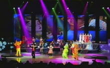 In this image made off North Korea's KRT video footage, North Korea's new Moranbong band and performers dressed as America's cartoon characters perform in Pyongyang, North Korea, Friday, July 6, 2012. Mickey Mouse and Winnie the Pooh took the stage for new leader Kim Jong Un, in an unusual performance featuring Disney characters in North Korea. (AP Photo/KRT)