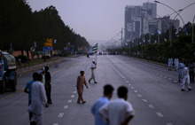 Pakistani protestors for wait the arrival of others to attend a rally condemning the movement of NATO supplies to Afghanistan through Pakistan, in Islamabad, Pakistan, Monday, July 9, 2012. Gunmen killed several people in an attack Monday on a Pakistani army camp in a city where thousands of hardline Islamists spent the night on their way to the capital to protest the government's recent decision to reopen the NATO supply line to Afghanistan, police said. Police were searching for the culprits and it was unclear if any of the Islamist protesters were involved, said Basharat Mahmood, police chief in the eastern city of Gujrat where the attack occurred. (AP Photo/Muhammed Muheisen)