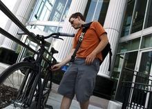 Leah Hogsten  |  The Salt Lake Tribune Bike courier Alex Smith heads for home after a day of delivering documents around Salt Lake City for Legal Messenger Inc., Friday, July 6, 2012 in Salt Lake City. Smith figures he makes about two to five trips to Matheson Courthouse every day. Next year, the state's courts will require electronic filing, and the city's bike messengers are sure to see a decline in jobs.