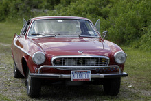 Irv Gordon's Volvo P1800 in Babylon, N.Y., Monday, July 2, 2012. Gordon's car already holds the world record for the highest recorded milage on a car and he is less than 40,000 miles away from passing three million miles on the Volvo.  (AP Photo/Seth Wenig)