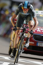 Christopher Froome of Britain strains in the last meters of the 9th stage of the Tour de France cycling race, an individual time trial over 41.5 kilometers (25.8 miles) with start in Arc-et-Senans and finish in Besancon, France, Monday July 9, 2012. (AP Photo/Laurent Rebours)