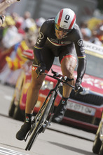 Fabian Cancellara of Switzerland strains in the last meters of the 9th stage of the Tour de France cycling race, an individual time trial over 41.5 kilometers (25.8 miles) with start in Arc-et-Senans and finish in Besancon, France, Monday July 9, 2012. (AP Photo/Laurent Rebours)
