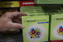 A customer holds Webroot's SecureAnywhere Complete 2012 software for computer security at Best Buy in Mountain View, Calif., Friday, July 6, 2012. After repeated alerts, only a few Americans lost their Internet service Monday. The warnings about the Internet problem have been splashed across Facebook and Google. Internet service providers have sent notices, and the FBI set up a special website. (AP file photo)