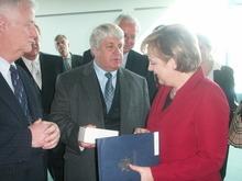 Courtesy photo Rep. Rob Bishop exchanges greetings with German Chancellor Angela Merkel.