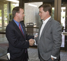 Paul Fraughton | Salt Lake Tribune Mark Crockett, right, receives a congratulatory handshake from GOP opponent Mike Winder upon arriving at the Salt Lake County Government Center, where a canvass of the June 26 primary election determined that Crockett had won their race for the Republican mayoral nomination by more than 1,000 votes.