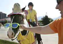 Scott Sommerdorf  |  Tribune file photo Sierra Engle's horse, Ace, endures the indignity of wearing a tourist costume including goofy sunglasses at the Days of '47 Horse Parade in July 2008. The Days of '47 celebration honors the pioneers who trekked westward to settle Utah in 1847.
