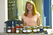 Chris Detrick  |  The Salt Lake Tribune Alison Einerson poses for a portrait with some of her pickled foods at her home in Salt Lake City Wednesday July 11, 2012. She has been pickling for over seven years and usually produces over 300 jars a year, using several dozen varieties of vegetables. Einerson is teaching several canning and pickling classes this summer through Wasatch Community Gardens and The Downtown Farmers Market.