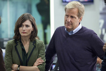 This publicity image released by HBO shows Emily Mortimer as Mackenzie MacHale , left, and Jeff Daniels as Will McAvoy on the HBO series,