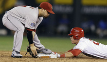 American League's Mike Trout, of the Los Angeles Angels, steals second base against National League's Jose Altuve, of the Houston Astros, during the sixth inning of the MLB All-Star baseball game, Tuesday, July 10, 2012, in Kansas City, Mo. (AP Photo/Jeff Roberson)