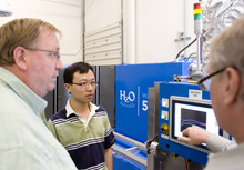 Kim Raff | The Salt Lake Tribune (from left) Kent Naylor, Raleigh Cao, and Dana Cox engineers from HzO, a company with a chemical called WaterBlock which water-proofs cell phones and other technology, work on the WaterBlock 5000 in their new facility in Draper, Utah on July 11, 2012.