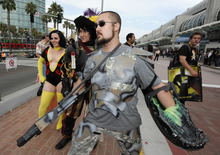 Fans pose for photos outside of the San Diego Convention Center before Comic-Con preview night on Wednesday July 11, 2012, in San Diego.  (Photo by Denis Poroy/Invision/AP)