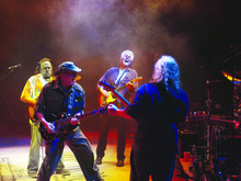Stephen Stills, Neil Young, Graham Nash and David Crosby (from left) perform onstage in their
