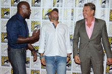 Actors Dolph Lundgren, right, Randy Couture, center, and Terry Crews pose together at the press line for