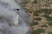 Paul Fraughton  |  The Salt Lake Tribune Helicopter drops water on hot spot above Alpine July 3. Farmers and ranchers in 1,016 counties -- about a third of those in the entire country on land covering half the nation -- are  now eligible for low-interest loans to help them weather the drought, wildfires and other disasters.