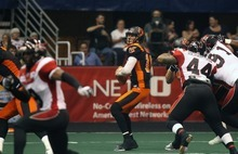 Kim Raff | The Salt Lake Tribune Utah Blaze quarterback drops in the backfield for a pass during a game against the Cleveland Gladiators at the EnergySolutions Arena in Salt Lake City, Utah on July 13, 2012.