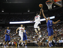 James Harden (12) of the USA Basketball Men's National Team goes to the basket over the Dominican Republic's Josh Asselin (5) at the Thomas and Mack Center in Las Vegas on July 12, 2012. (AP Photo/Las Vegas Review-Journal, Jason Bean)