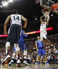 Tyson Chandler (4) of the USA Basketball Men's National Team dunks over the Dominican Republic's Elys Guzman (11) at the Thomas and Mack Center in Las Vegas on July 12, 2012. (AP Photo/Las Vegas Review-Journal, Jason Bean)